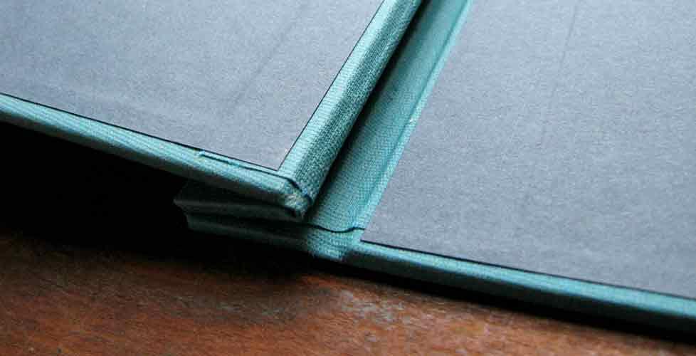 encuadernacion-portfolio-carpeta-tornillos